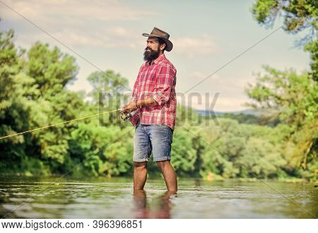 Hobby Is Matter Of Attitude. Fisherman Show Fishing Technique Use Rod. Successful Fly Fishing. Summe