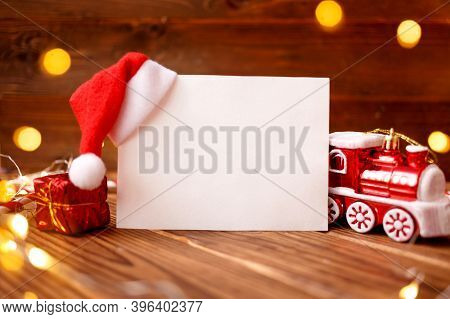Christmas Composition Greeting Card. Gift With Decoration And Paper Blank For Goals, Plan Or Wishlis