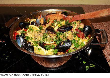 A Pan Of Seafood Paella Ready To Be Served On The Stove