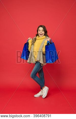 Happy Small Shopaholic With Fashion Look Carry Shopping Bags Red Background, Shopaholism.