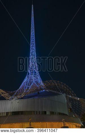 Melbourne Australia - March 9 2020; Melbourne Art's Centre Spire Rising Above Building Illuminated B