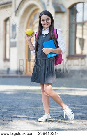 Get Vitamin From Healthy Diet. Happy Child Hold Apple Outdoors. School Snack. Vitamin Nutrition. Hea
