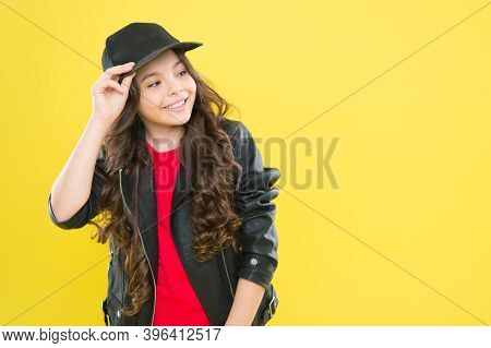Dressing Her Up In The Best Clothes And Outfits In Fashion Salon. Happy Child Fix Cap Yellow Backgro