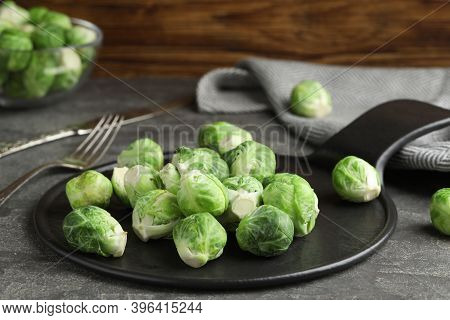Fresh Brussels Sprouts On Grey Table, Closeup