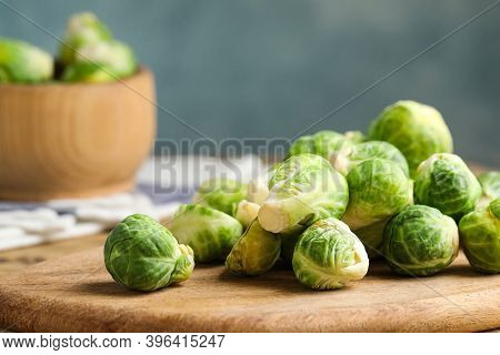 Fresh Brussels Sprouts On Wooden Board, Closeup