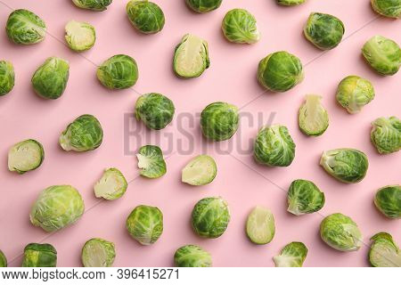 Fresh Brussels Sprouts On Pink Background, Flat Lay