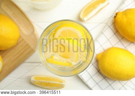Soda Water With Lemon Slices And Fresh Fruits On White Wooden Table, Flat Lay