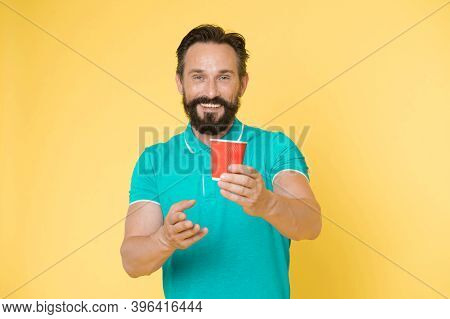 Recyclable Coffee Cup. Hipster Mature Man Hold Paper Coffee Cup Stand Yellow Background. Relaxing Co