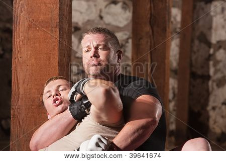 Fighter Struggling In Choke Hold