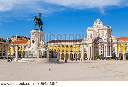 Lisbon, Portugal - October 31, 2020: Praca do Comercio or Commerce square, people and houses view in downtown of Lisbon, Portugal.