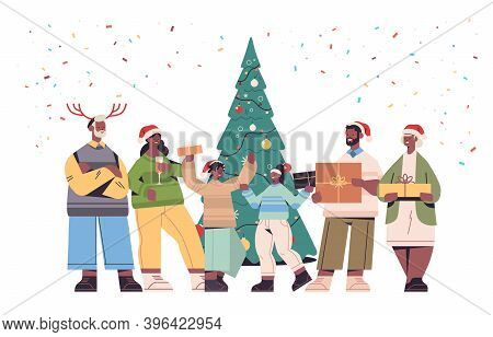 African American Multi Generation Family In Santa Claus Hats Holding Wrapped Gift Boxes Happy New Ye