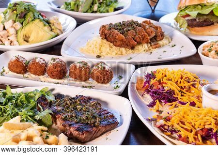 Large Variety Of Choices Of Tasty Plates Of Food From The Bistro Served Buffet Style On The Table.