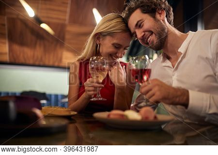 A young couple in romantic moments at Valentine's day celebration in restaurant in a relaxed atmosphere. Together, Valentine's day, celebration