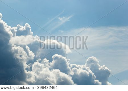 Cumulus And High-cumulus Clouds Of An Average Tier On Blue Heavenly Space