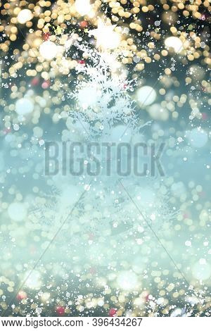 Christmas Concept: Christmas Lights On A Cold Blue Winter Background