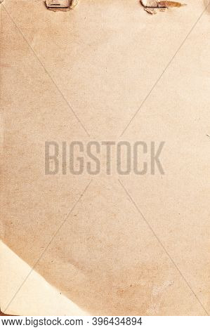 Texture Of Beige Old Paper With Rust Clip And Folded Corner, Crumpled Background. Vintage Brown Grun