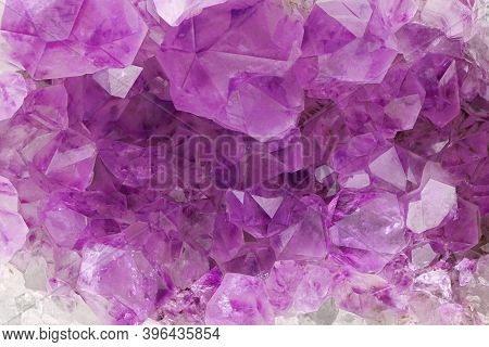 Purple Amethyst Background. Lilac Mineral Amethyst. Violet Crystal Stone. Abstract Background.