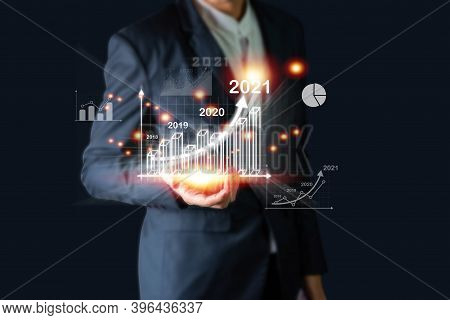 Businessman Investor Man Hand Holding Trend Chart Growing Up From 2020 To 2021, Business Investment