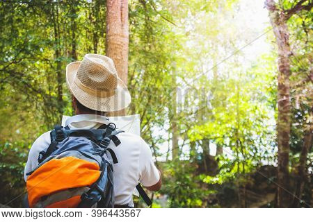 Travelers Trekking To Study Nature In East Asia Thailand Holds A Navigation Map