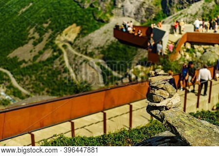 Stone Stack And Many People Tourist On Trollstigen Viewpoint In Norway Europe, Popular Tourist Attra
