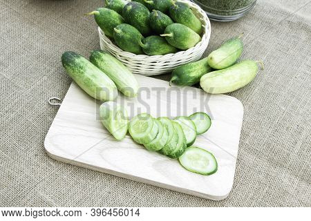Cucumber Fresh Sliced On Basket And Cutting Board On The Sackcloth Background For Cooking Ingredient