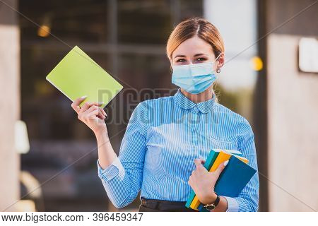 The Happy Teacher With Face Mask After Lockdown