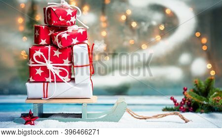 Christmas Presents On A Wooden Sledges With Festive Background