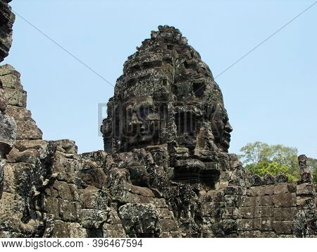 Siem Reap, Cambodia, April 6, 2016: Two Women's Faces Carved In The Stone At Bayon Temple In The Khm
