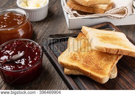 Toast with jam on a wooden table