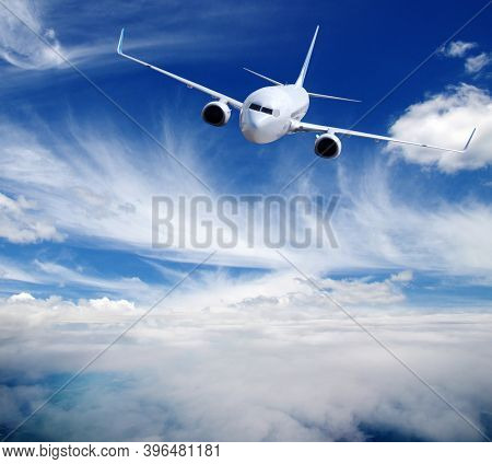 Airplane in the sky. Passenger Airliner in clouds.  Aircraft is flying.