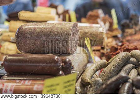 Pork Delicacies Displayed On The Market Counter For Sale - Brawn, Deer, Sausage.
