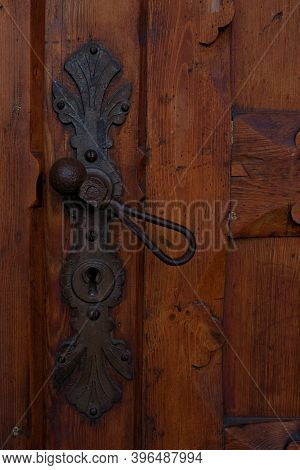 Cast Iron Medieval Door Knob And Keyhole On An Old Wooden Door.