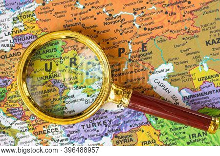 Lviv Ukraine-25 11 2020: Ukraine, Kiev, On The Map Of Europe A Defocused Magnifying Glass, The Theme