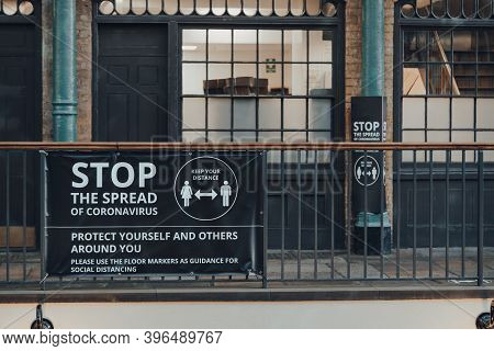London, Uk - November 19, 2020: `stop The Spread Coronavirus Warning Sign In Covent Garden Market, O