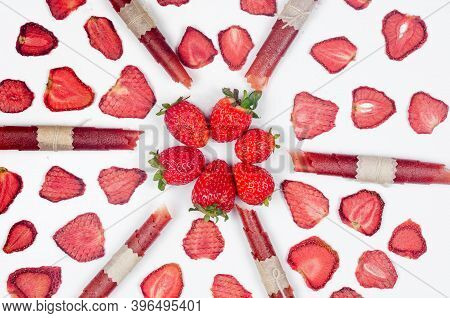 Ripe Raw Strawberry And Dried Strawberry Slices Chips Scattered On White Background. Fruit Chips. He