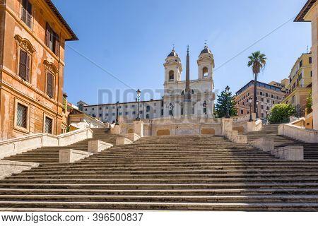 Empty historic spanish stairs and Chiesa della Trinita dei Monti church at Piazza di Spagna in Rome, Italy