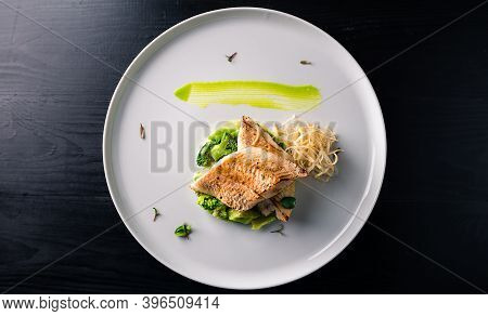 Cod Fillet With Broccoli, Fried Breaded Fish Fillets With Broccoli On Black