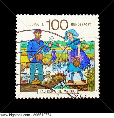 Germany - Circa 1991 : Cancelled Postage Stamp Printed By Germany, That Shows Mailman Delivering Mai