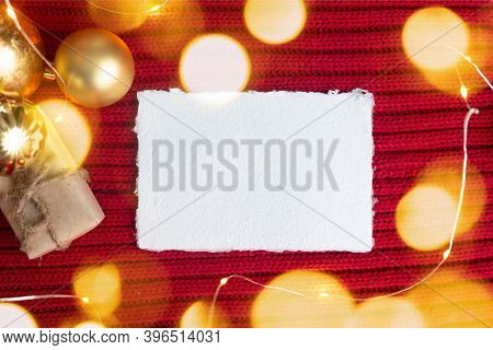 A Sheet Of Paper With The Inscription Merry Christmas Surrounded By New Year`s Decorations. Mock Up