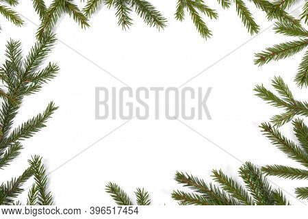 Natural fir Christmas tree border frame isolated on white , copy space for text