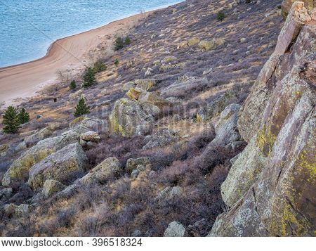 climbing cliff over mountain lake - Duncan's Ridge and Horestooth Reservoir in northern COlorado in fall scenery