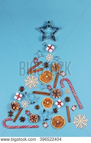 Christmas Tree made of decor on blue paper background. Christmas Holiday Concept. Flat Lay