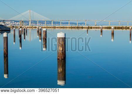 Pier with view on Vasco da Gama bridge on the Tejo river. Lisbon, Portugal.