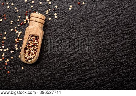 Mixed Quinoa Red, White And Brown Quinoa In Wooden Scoop. Healthy And Diet Superfood Product. Banner