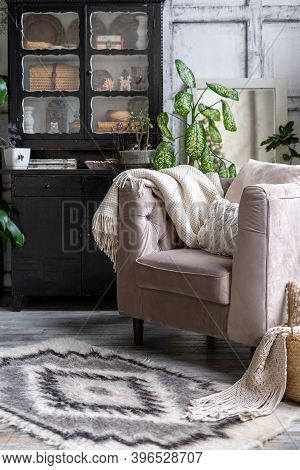 Vertical Photo Of Black Vintage Chest Of Drawers Near Comfortable Armchair With Cozy Plaid And Cushi