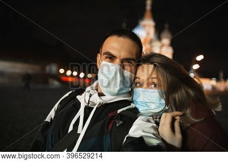 Happy Romantic Couple Of Tourists In Medical Masks Makes Selfie Self-portrait In Front Of St. Basils