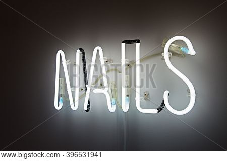 Shining Nails White Neon Label. Advertising For Beauty Salon