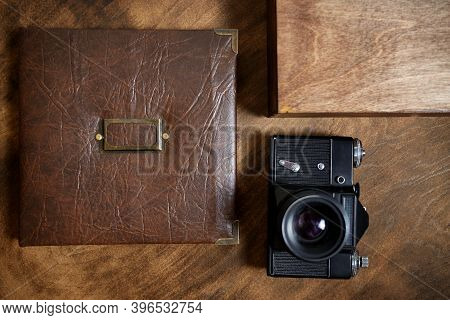 Gift Photo Book In A Leather Cover In A Wooden Box On A Wooded Background. Vintage Photo Album. Seme