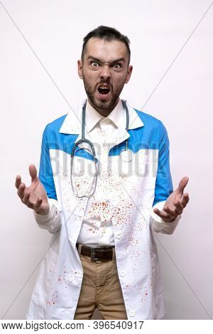 Evil Doctor Maniac Angry And Mad Frustrated And Furious While Shouting With Anger. Rage And Aggressi