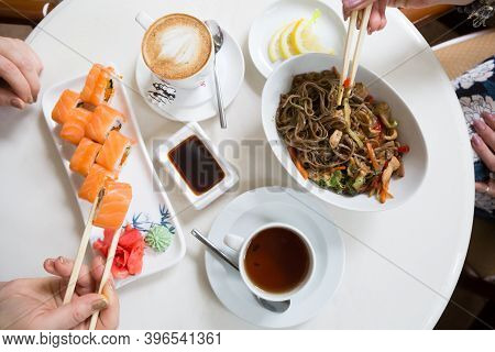 Two Women Eating Asian Food In A Cafe